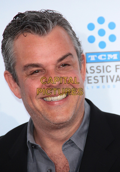 "DANNY HUSTON .TCM Classic Film Festival - ""A Star Is Born"" - Arrivals held at Grauman's Chinese Theatre, Hollywood, California, USA, 22nd April 2010..portrait headshot  smiling grey gray shirt .CAP/ADM/TC.©T. Conrad/AdMedia/Capital Pictures."