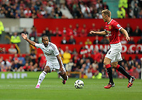 Pictured L-R: Wayne Routledge of Swansea against Darren Fletcher of Manchester United. Saturday 16 August 2014<br />