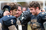 ANSONIA, CT. 02 December 2018-120218 - Larry Cafaro, center father of Ansonia players Tyler Cafaro #17, left, and Garrett Cafaro #86 hugs his sons telling them he loves them and is proud of them after Ansonia got beat by Bloomfield 26-19 during the Class S Semi-final game between Bloomfield and Ansonia at Ansonia High School in Ansonia on Sunday. Bill Shettle Republican-American