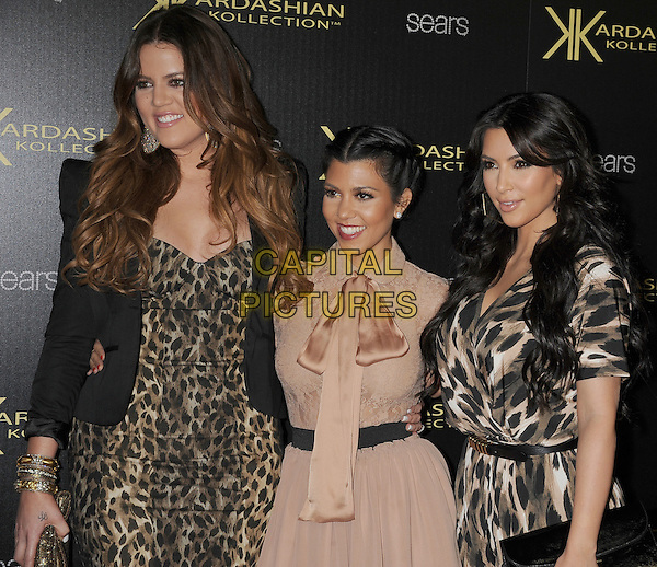 Khloe Kardashian Odom, Kourtney Kardashian & Kim Kardashian.The Launch Party for The Kardashian Kollection for Sears held at The Colony in Hollywood, California, USA..August 17th, 2011.half length black brown white beige pink nude cream dress jacket blazer leopard jumpsuit print pussybow family sisters siblings .CAP/ROT/TM.©Tony Michaels/Roth Stock/Capital Pictures
