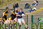 Barry John Walsh Kerins O'Rahillys is tackled by Shane Doolan Dr Crokes in the Divison 1 league final in Killarney on Sunday