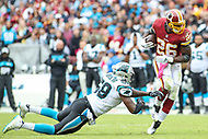 Landover, MD - October 14, 2018: Washington Redskins running back Adrian Peterson (26) breaks Carolina Panthers linebacker Thomas Davis (58) tackle during the  game between Carolina Panthers and Washington Redskins at FedEx Field in Landover, MD.   (Photo by Elliott Brown/Media Images International)