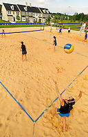 Lifestyle photography of Berewick, a 1,000-acre neighborhood development in Charlotte, NC (Steel Creek Area). Berewick was developed by Pappas Properties. Photo shows the community's sand volleyball court.