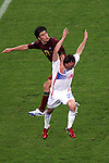 05 July 2006: Nuno Valente (POR) (14) climbs the back of Frank Ribery (FRA) (22). France defeated Portugal 1-0 at the Allianz Arena in Munich, Germany in match 62, the second semifinal game, in the 2006 FIFA World Cup.