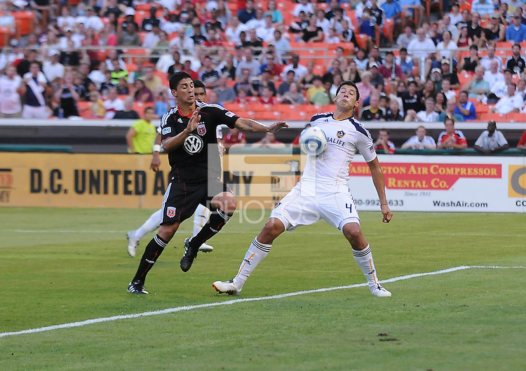 LA Galaxy defender Omar Gonzalez (4) defends the play against DC United forward Pablo Hernadez (21)  LA Galaxy defeated DC United 2-1 at RFK Stadium, Saturday July 18, 2010.
