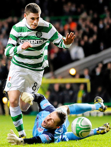 26TH JAN 2011, CELTIC V HEARTS, CELTIC PARK, GLASGOW, MARIAN KELLO BRINGS DOWN GARY HOOPER RESULTING IN A TAP IN FOR ANTHONY STOKES 3-0, ROB CASEY PHOTOGRAPHY.