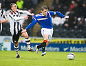 RANGERS' STEVEN DAVIS IS PULLED BACK BY ST MIRREN'S DAVID BARRON