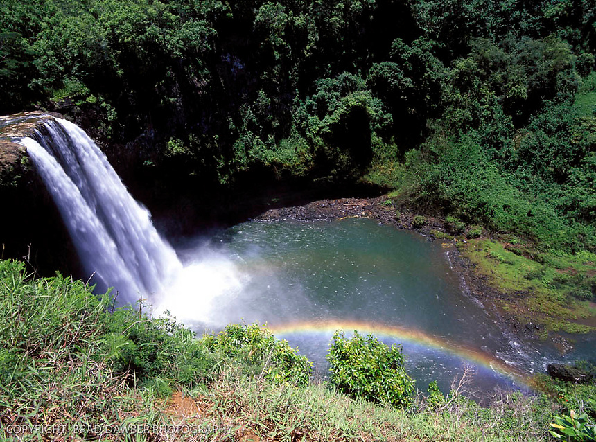 "Wailua Falls before big guardrail, you could ""hang"" over the side to get the rainbow in the image."
