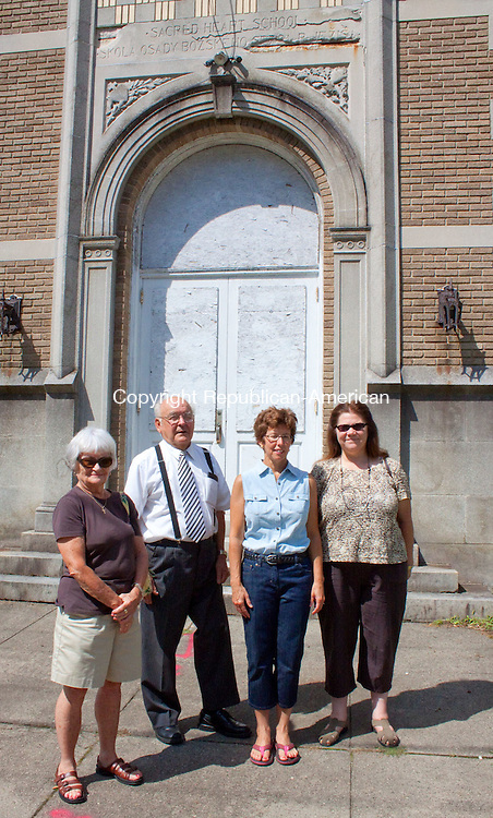 TORRINGTON CT-AUGUST 16 2011 -081612DA07- Alumni of Sacred Heart School in Torrington revisit the old building that will be demolished after getting the green light from the Hartford Diocese. From left, Claire McDonald, class of 48, Bernie Blach, class of 44, Bonnie Landor-Rossi, class of 74, and Cheryl Zukowski, class of 70, all of Torrington..Darlene Douty Republican-American