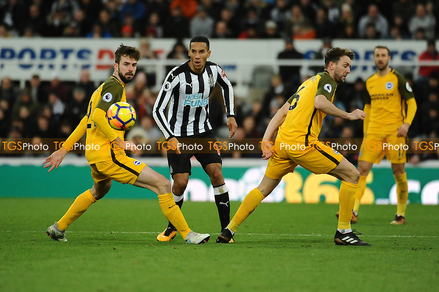 Isaac Hayden of Newcastle United battles with Shane Duffy of Brighton and Hove Albion during Newcastle United vs Brighton & Hove Albion, Premier League Football at St. James' Park on 30th December 2017