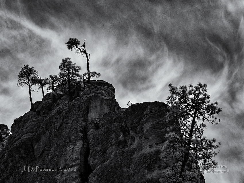 Gothic Ridge, West Fork, Arizona (Infrared) ©2016 James D Peterson.  Rugged pines and a towering cliff are silhouetted against swirling clouds above West Fork canyon, north of Sedona.
