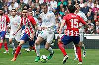 Real Madrid's Gareth Bale (c) and Atletico de Madrid's Saul Niguez (l) and Stefan Savic during La Liga match. April 8,2018. (ALTERPHOTOS/Acero) /NortePhoto NORTEPHOTOMEXICO