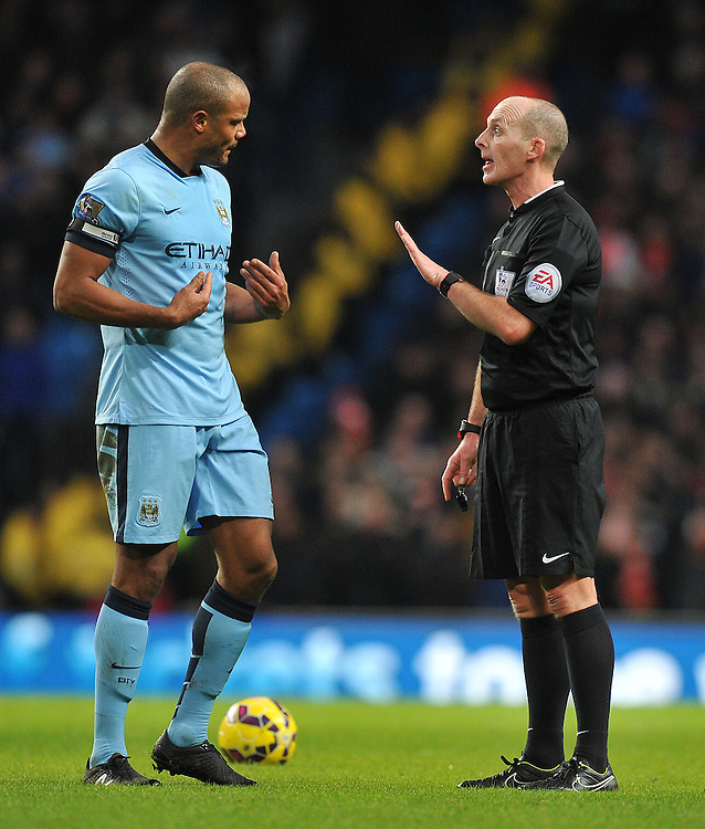 Do you mean me? asks Manchester City's Vincent Kompany of referee Mike Dean<br /> <br /> Photographer Dave Howarth/CameraSport<br /> <br /> Football - Barclays Premiership - Manchester City v Arsenal - Sunday 18th January 2015 - Etihad stadium - Manchester<br /> <br /> &copy; CameraSport - 43 Linden Ave. Countesthorpe. Leicester. England. LE8 5PG - Tel: +44 (0) 116 277 4147 - admin@camerasport.com - www.camerasport.com