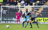 Aaron Pierre of Wycombe Wanderers clears from Jonathan Stead of Notts County during the Sky Bet League 2 match between Notts County and Wycombe Wanderers at Meadow Lane, Nottingham, England on 28 March 2016. Photo by Andy Rowland.