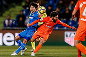 12th January 2018, Estadio Coliseum Alfonso Perez, Getafe, Spain; La Liga football, Getafe versus Malaga; Gaku Shibasaki (Getafe CF) fights for control of the ball with Manuel Iturra of Malaga