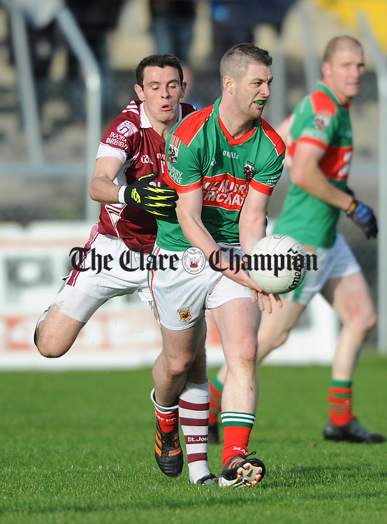 Enda Coughlan of Kilmurry Ibrickane in action against David O Brien of Doora Barefield during the senior county football final at Cusack park. Photograph by John Kelly.