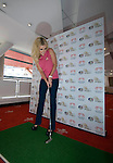 """The Welsh singer Katherine Jenkins poses with a golf club inside the Millennium Stadium in Cardiff today. She has been announced as the first major artist confirmed to perform at the """"Welcome to Wales"""" concert at the Millennium Stadium to mark the start of the 2010 Ryder Cup in Wales later this year.."""