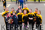 Members of Listowel Emmetts ladies team who play with Scoil an Chlochair marching  who took part in La na gClub parade in Listowel on Sunday last.