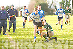 Tralee's Maurice Fitzgerald gets away from  Kanturk's Paul Cotter in the Munster Junior Shield at O'Dowd park, Tralee on Sunday.
