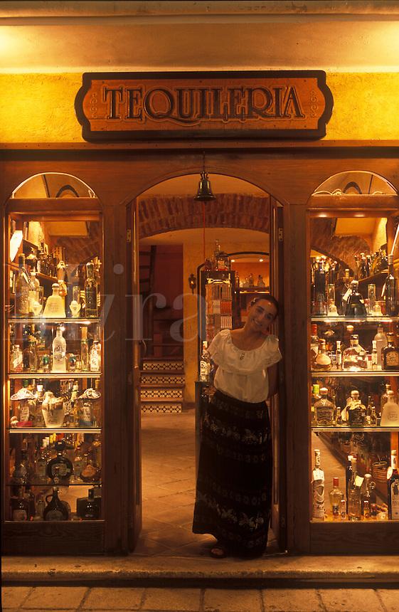 Tequileria. A shopkeeper in a tequila shop in Playa del Carmen. Yucatan Peninsula. Mexico