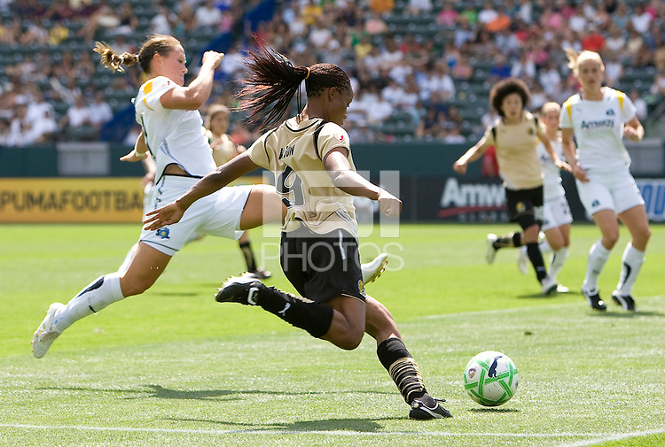 FC Gold Pride defender Kandace Wilson sends a ball over the middle past LA Sol's Brittney Bock. The LA Sol defeated FC Gold Pride of the Bay Area 1-0 at Home Depot Center stadium in Carson, California on Sunday April 19, 2009.  ..  .