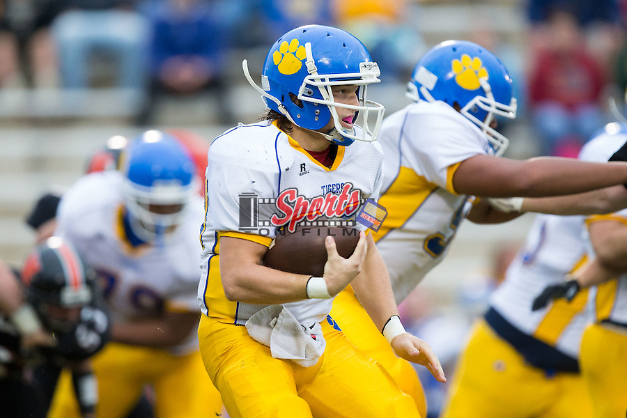 Cody Reece (20) of the Mount Pleasant Tigers runs with the football during first half action against the Northwest Cabarrus Trojans at Trojan Stadium October 1, 2015, in Concord, North Carolina.  The Tigers defeated the Trojans 42-0.  (Brian Westerholt/Sports On Film)