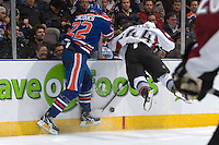 EDMONTON, AB - NOVEMBER 25:  Jean-Francois Jacques #22 of the Edmonton Oilers lays a huge hit on Ryan Wilson #44 of the Colorado Avalanche at Rexall Place on November 25, 2010 in Edmonton, Alberta, Canada. The Oilers beat the Avalanche 3-2.  (Photo by Andy Devlin/NHLI via Getty Images) *** LOCAL CAPTION *** Jean-Francois Jacques;Ryan Wilson
