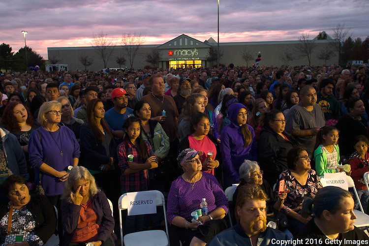BURLINGTON, WA - SEPTEMBER 26: Hundreds gather for a candlelight vigil outside the Cascade Mall on September 26, 2016 in Burlington, Washington. Behind them is the Macy's department store where five people were shot and killed by a gunman. The suspect, Arcan Cetin, 20, a resident of Oak Harbor, Washington, made a court appearance today. (Photo by Karen Ducey/Getty Images)