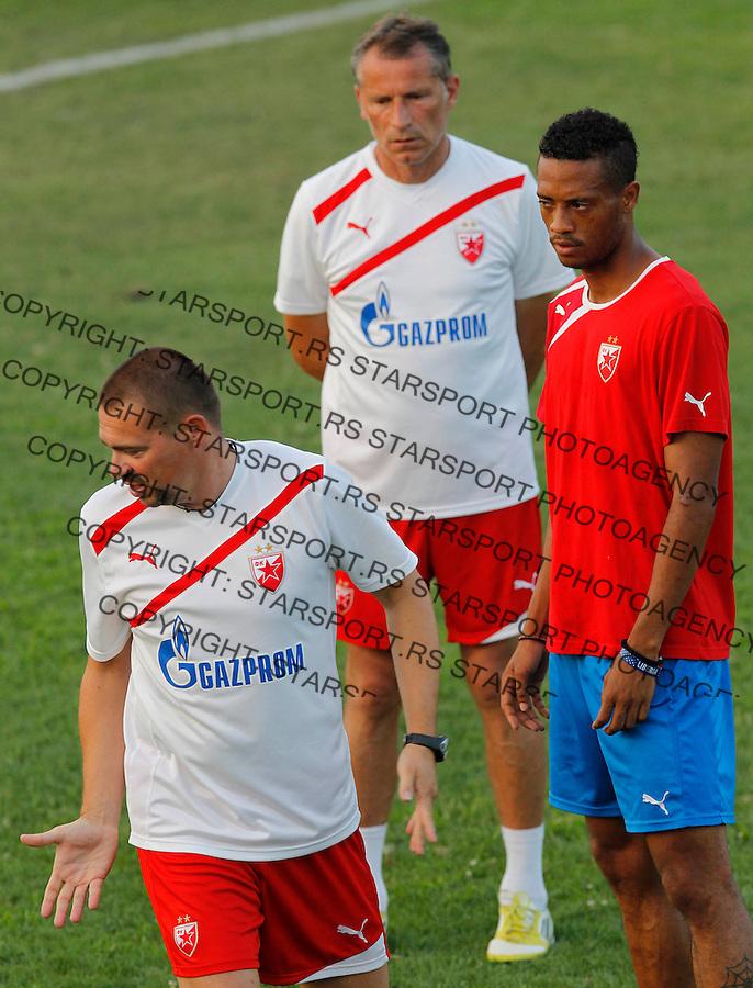 Fudbal <br /> Crvena Zvezda<br /> Practice session<br /> Milos Kostic left Ivica Momcilovic and Omega Roberts<br /> Beograd, 29.07.2013.<br /> foto: Srdjan Stevanovic/Starsportphoto &copy;
