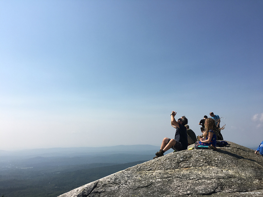 Orange N.H., Monday, Aug. 21, 2017:  People watching partial solar eclipse atop Mount Cardigan. (Photo by Cheryl Senter)