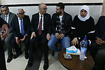 Palestinian Prime Minister Rami Hamdallah offers condolences to the family of Hamdan al-Arda, 60, who was killed by Israeli forces and abducted by them, alleged to attack soldiers with his vehicle, in the West Bank city of Ramallah, January 29, 2019. Photo by Prime Minister Office