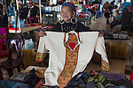 Hmong tribe shopkeeper at Muong Hum market, Vietnam.