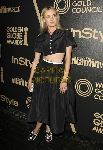 Diane Kruger.The Hollywood Foreign Press Association And InStyle Miss Golden Globe 2013 Party held at Cecconi's Restaurant, West Hollywood, California, USA, 29th November 2012..full length cropped crop top midriff shirt buttons skirt black  white belt clutch bag  .CAP/ADM/KB.©Kevan Brooks/AdMedia/Capital Pictures.