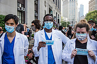 NEW YORK, NEW YORK - MAY 29: A medical workers protests against the police in response to the police officer who killed George Floyd in Minneapilis in front of the Manhattan court on May 29, 2020 in New York. Across the country, protests against Floyd's death have sparked movements day and night. (Photo by Pablo Monsalve / VIEWpress via Getty Images)