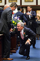 TALLAHASSEE, FLA. 3/3/15-Sen. Garrett Richter, R-Naples, right, joking kneels as he greets Rep. Jim Boyd, R-Bradenton, left as Richter enters the chamber to hear the State of the State address the during the opening day of the 2015 Legislative Session, Tuesday at the Capitol in Tallahassee.<br /> <br /> COLIN HACKLEY PHOTO