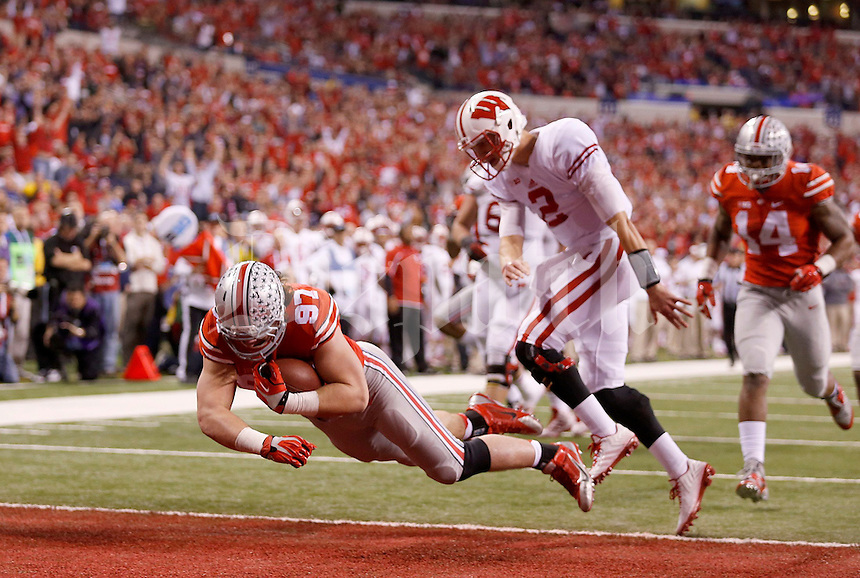 Ohio State Buckeyes defensive lineman Joey Bosa (97) jumps into the end zone in front of Wisconsin Badgers quarterback Joel Stave (2) in the second quarter of the Big Ten Championship game at Lucas Oil Stadium in Indianapolis on Saturday, December 6, 2014. (Columbus Dispatch photo by Jonathan Quilter)