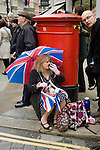 A female supporter with Union Jack umbrella near St Paul's Cathedral before the funeral of Margaret Thatcher, London, 17 April 2013.<br />