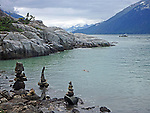 stacked stones at the water's edge, looking out to Taiya Inlet from Yakutania Point in Skagway, Alaska