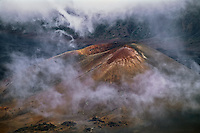 Clouds in the crater appear as a ring around the cinder cone in HALEAKALA NATIONAL PARK on Maui in Hawaii