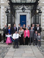 03/06/2014  <br /> (L to r) back Row Peter mcverry <br /> Fiona Doyle <br /> David carrie <br /> John o donoghue<br /> Mary heffernan<br /> Tony heffernan<br /> Vinnie Flanagan<br /> Gavin leane<br /> <br /> front row (L to r)  <br /> Alyssa Kelly 6<br /> Brian hogan <br /> Karen Morrison<br /> Sister Helen culhane <br /> Adam Horgan <br /> Gavin Kelly 8<br /> Liam Kelly 6<br /> during the Pride of Ireland awards at the Mansion House, Dublin.<br /> Photo: Gareth Chaney Collins