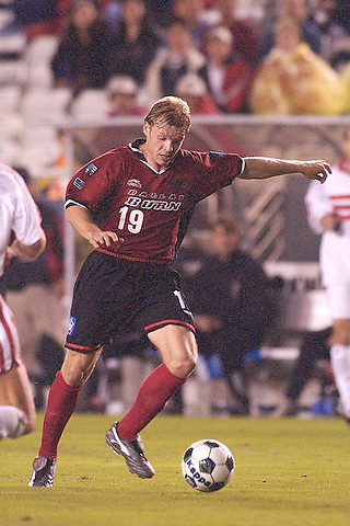 DALLAS, TX -APRIL 6: Bobby Rhine #19 of the Dallas Burn  in action against DC United at Cotton Bowl in Dallas on April 6, 2002 in Dallas, Texas. Burn win 2-1.  (Photo by Rick Yeatts) Rhine's career consisted of 212 games making 136 starts, played more than 12,000 minutes scoring 23 goals and 34 recorded assists.