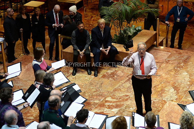 WWW.ACEPIXS.COM<br /> January 20, 2015 New York City<br /> <br /> Lorenzo Lamas and Donald Trump watch a choir at Trump Tower  in New York City on January 15, 2015.<br /> <br /> By Line: Kristin Callahan/ACE Pictures<br /> ACE Pictures, Inc.<br /> tel: 646 769 0430<br /> Email: info@acepixs.com<br /> www.acepixs.com