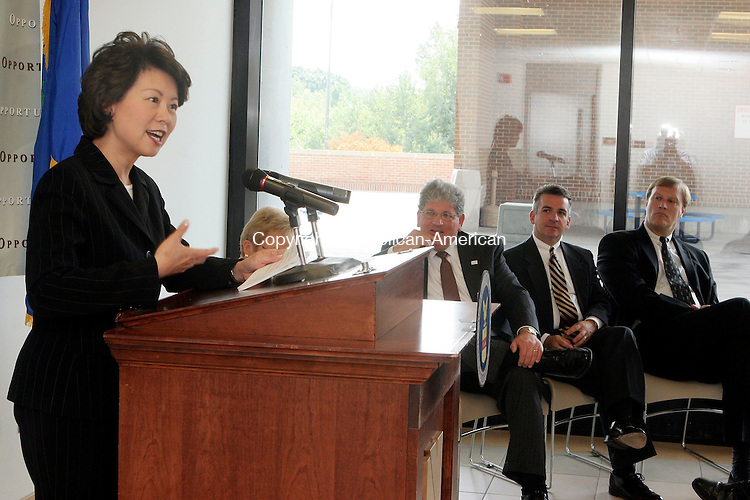 WATERBURY, CT-08September 2006-090806TK14- (left to right)  On Friday, Secretary of Labor Elaine L. Chao visited Naugatuck Valley Community College to announce an award of $2,748,405 grant to the Connecticut Department of Economic and Community Development to help train workers for the financial services and insurance industries. Listening to the grant announcement was Marc S. Herzog, Chancellor of Connecticut Community Colleges, Robert Flynn, Executive Director of Insurance and Financial Services Cluster, State of Connecticut and James Abromaitis, Connecticut Commissioner of DECD. Tom Kabelka Republican-American (Elaine L. Chao, Marc S. Herzog, Robert Flynn, James Abromaitis)