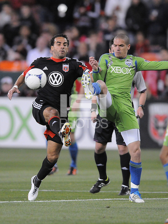 D.C. United forward Dwayne De Rosario (7) goes against Seattle Sounders midfieler Osvaldo Alonso (6)  D.C. United tied the Seattle Sounders, 0-0 at RFK Stadium, Saturday April 7, 2012.