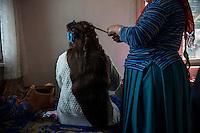 Rossi prepares to go to the annual Tinsmith gathering in Stara Zagora. Her sister Donka is helping her with last touches on her hair. Rossi is the girl with the longest hair in the tribe.  This makes her very expensive on the 'bride market'. Her mother is asking 30,000 Bulgarian leva for Rossi (15,000 Euros). This price is more than most boys can pay so Rossi, now 27 years old is still unmarried. Once she fell in love with a boy but he was poor and not able to pay the dowry. Rossi eloped but her five brothers went after her and brought her back home. She did not lose her virginity and her price remains unchanged. Ognianovo, Bulgaria. He Came on a White Horse.