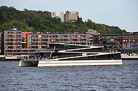 Sightseeing vessel, Vision of The Fjords, in Oslo harbour, next the the Opera.  During sightseeing the vessel will be powered by batteries only, while in transit it can use diesel engines to increase the range. The batteries can be charged ether by on-shore power or by the engines on board.<br /> <br /> The hybrid-electric carbon fiber catamaran is designed and built by Br&oslash;drene Aa. The ship is designed to carry 400 passengers and is normally operating in N&aelig;r&oslash;yfjord on the west coast of Norway.  <br /> <br /> &copy; Fredrik Naumann/Felix Features