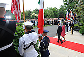 United States President Barack Obama and First Lady Michelle Obama wait for Mexican President Felipe Calderon to arrive during Calderon's welcoming ceremony on the South Lawn of the White House in Washington on Wednesday, May 19, 2010. .Credit: Kevin Dietsch - Pool via CNP