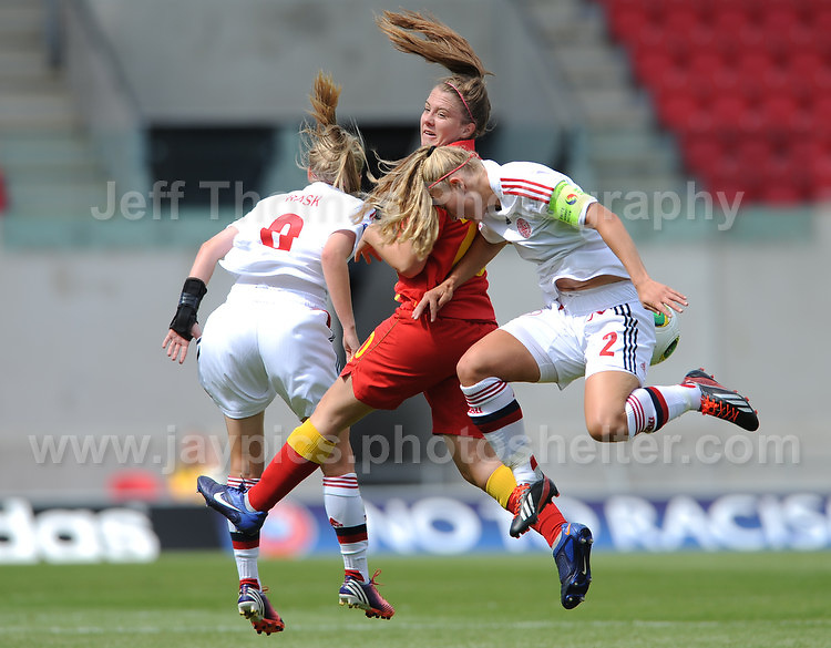 Emma Beynon of Wales battles with Caroline Rask and Mie Leth Jans of Denmark during the UEFA Womens U19 Championships at Parc y Scarlets, Monday 19th August 2013. All images are the copyright of Jeff Thomas Photography-www.jaypics.photoshelter.com-07837 386244-Any use of images must be authorised by the copyright owner.