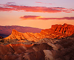 The Manley Peak Ablaze With Orange Light As If Lit From Within At First Light Of Dawn Over Zabriskie Point, Death Valley National Park, California, USA