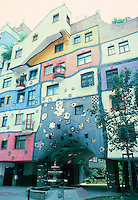 Friedensreich Hundertwasser: Hudertwasser House. Artistic, colorful apartment building. Photo '87.